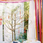 Vietnamese wedding ceremony with colorful streamer backdrop