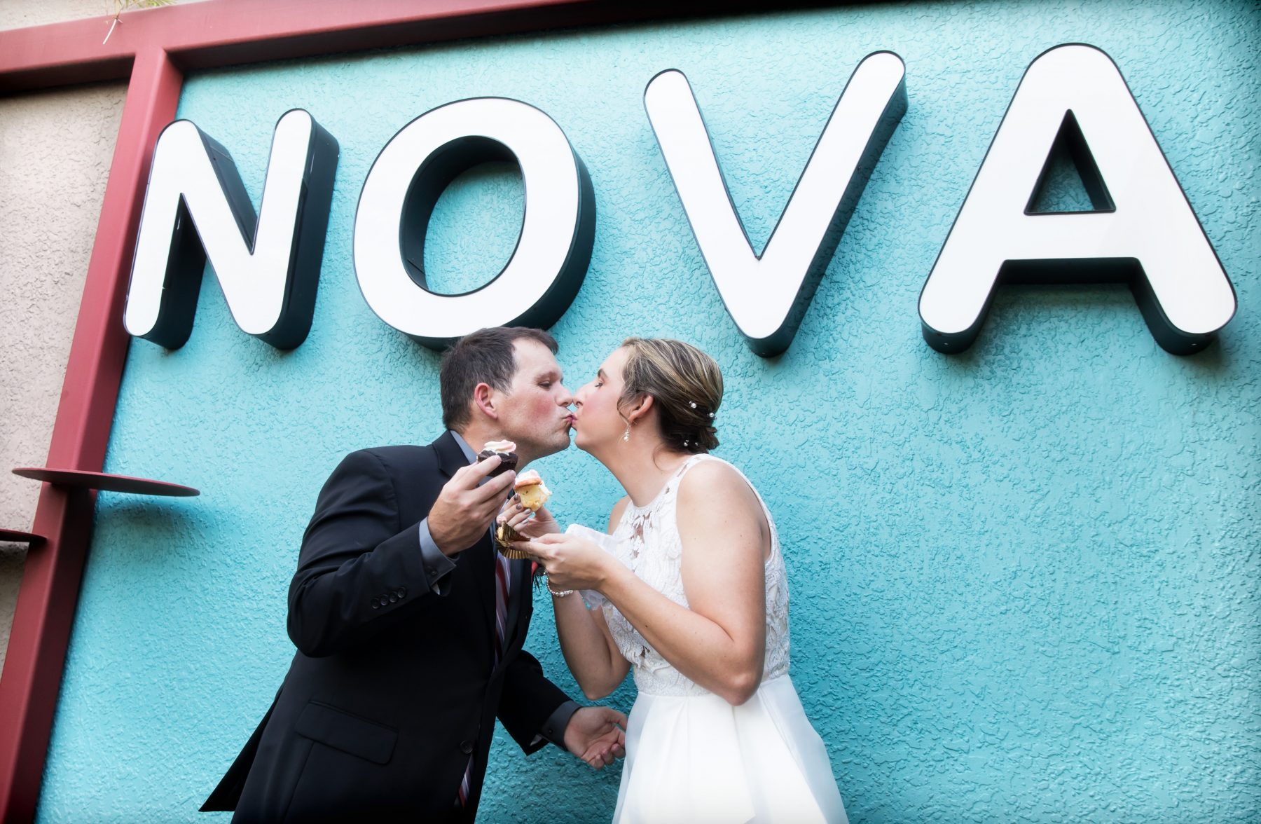 Newlyweds enjoy cupcake at NOVA 535 during their vintage St. Petersburg wedding