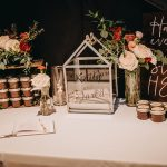 Industrial chic wedding decor with jam favors at Historic Wedding Venue NOVA 535 in Tampa Bay
