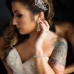 Bride in embellished strapless wedding dress with rhinestone headpiece