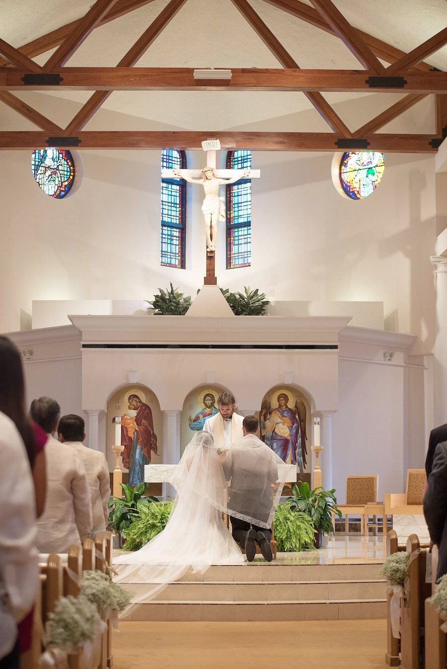 Bride And Groom During Wedding Ceremony At St Raphael Catholic Church