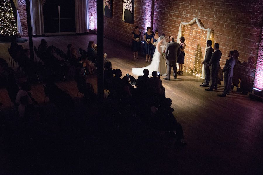 Indoor Wedding Ceremony with Exposed Brick Wall Backdrop at Modern, Downtown St. Pete Wedding Venue NOVA 535