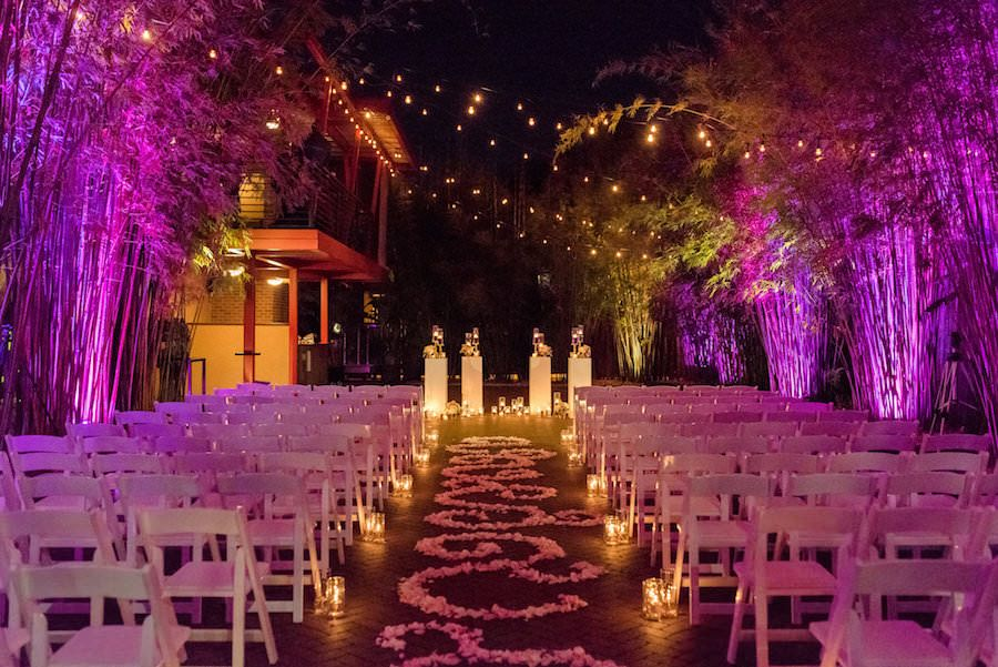 Outdoor, Nighttime St. Petersburg Wedding Ceremony Aisle with Pink Uplighting and Aisle of Flowers | St. Pete Wedding Venue NOVA 535 | valentine's day inspired wedding