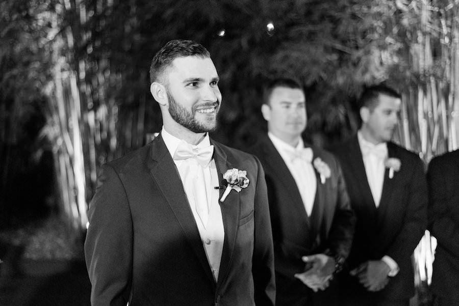 Outdoor, Nighttime Wedding Ceremony, Groom Watching Bride Walk Down Aisle | St. Petersburg Wedding Photographer Caroline & Evan Photography