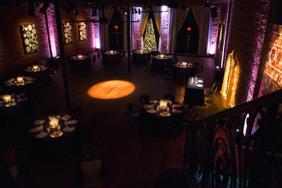 Romantic Wedding Reception with Round Tables and Exposed Brick Wall Backdrop at Modern, Downtown St. Pete Wedding Venue NOVA 535 for a romantic st. petersburg wedding