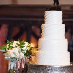 4-tiered Round White Wedding Cake with Texture and Bride and Groom Cake Topper