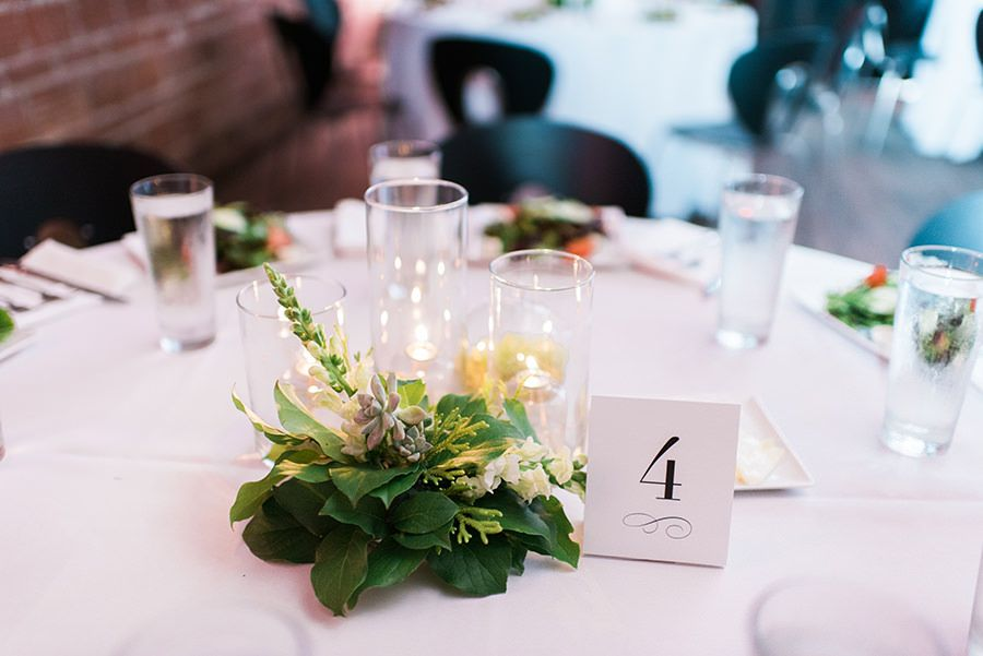 Candle wedding centerpieces with greenery and succulents