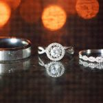 Bride and Groom Wedding and Diamond Halo Engagement Ring Portrait