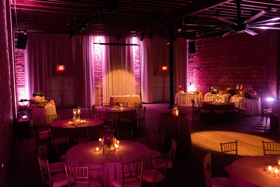 romantic valentines inspired wedding reception with pink uplighting at st pete wedding venue