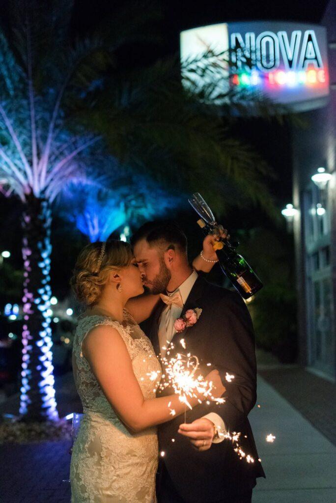Outdoor, Nighttime Wedding Portrait with Sparkler | St. Pete Wedding Venue NOVA 535 | St. Petersburg Wedding Photographer Caroline & Evan Photography | valentine's day inspired wedding