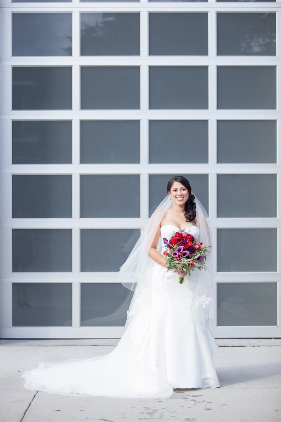 Bridal Portrait in White David's Bridal Sweetheart Strapless Wedding Dress and Red and Purple Wedding Bouquet with Greenery