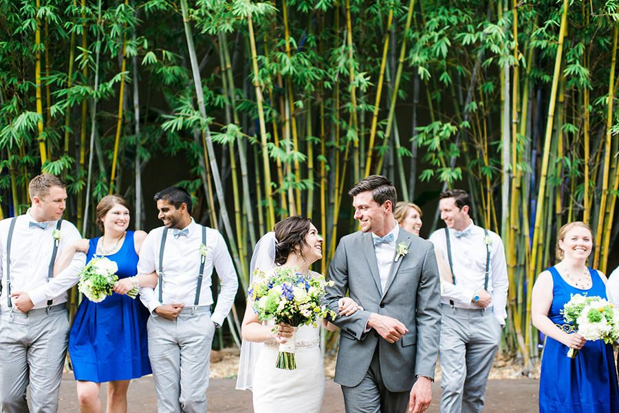 Wedding Bridal Portraits in Blue Bridesmaid Dresses in Bamboo Garden | White and Green Wedding Ceremony Decor with Exposed Brick Wall | St. Petersburg Wedding Venue NOVA 535 | Green and Blue Non Beach Florida Destination Wedding