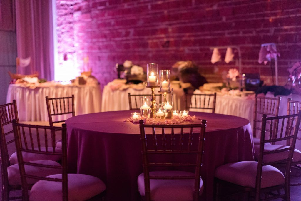 Modern, Romantic Wedding Reception Table Decor with Pink and White Flower Centerpieces and Tea Lights and Pink Uplighting | St. Pete Wedding Venue NOVA 535