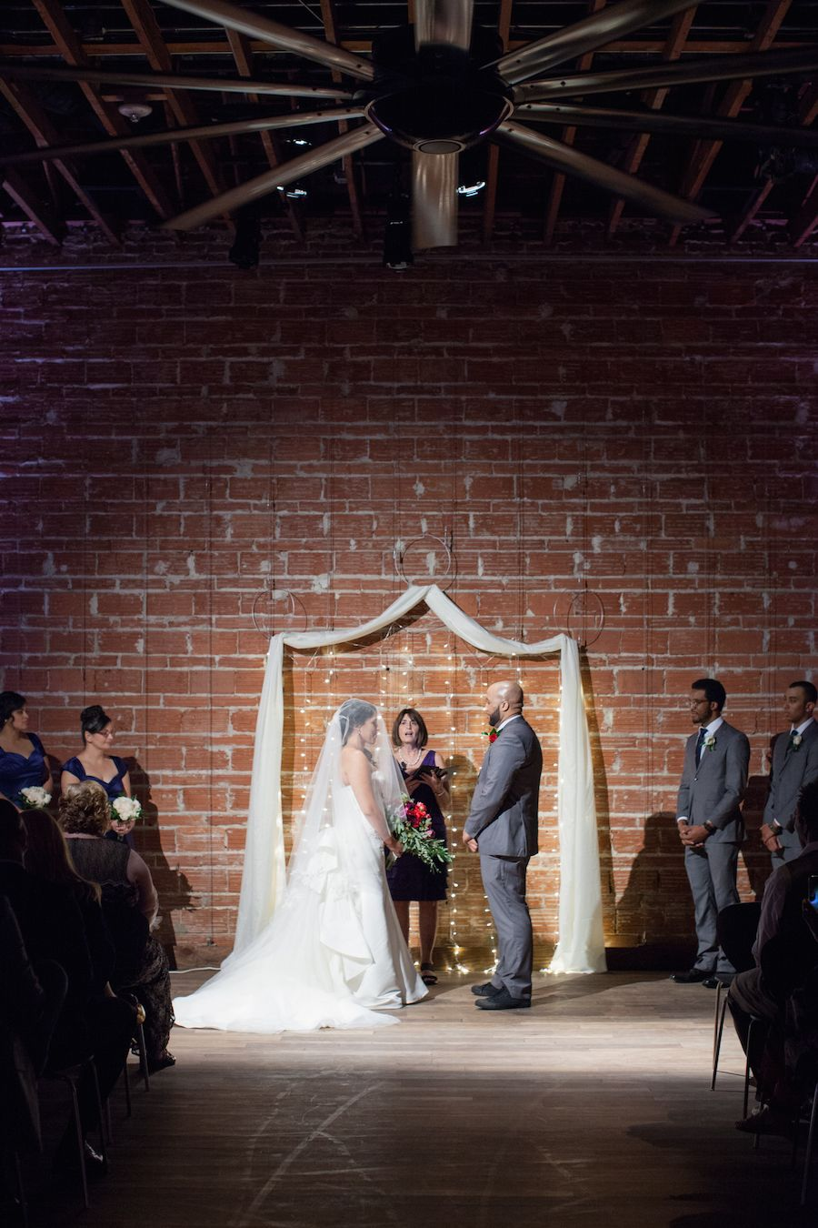 Bride and Groom Wedding Ceremony Portrait with Exposed Brick Wall Backdrop at Modern, Downtown St. Pete Wedding Venue NOVA 535 for a romantic st. petersburg wedding