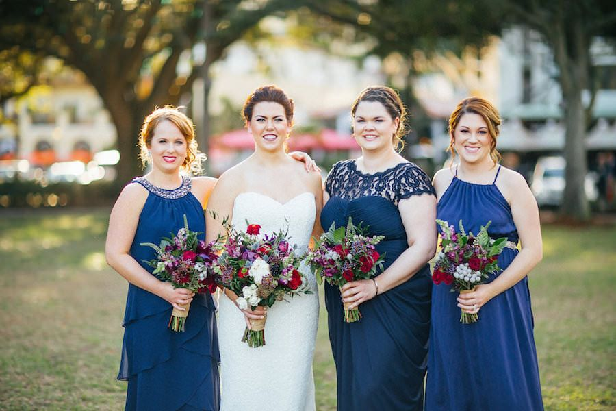 Navy Blue Mis-Matched Bridesmaid Dresses with Red and Pink Wedding Bouquet with Greenery