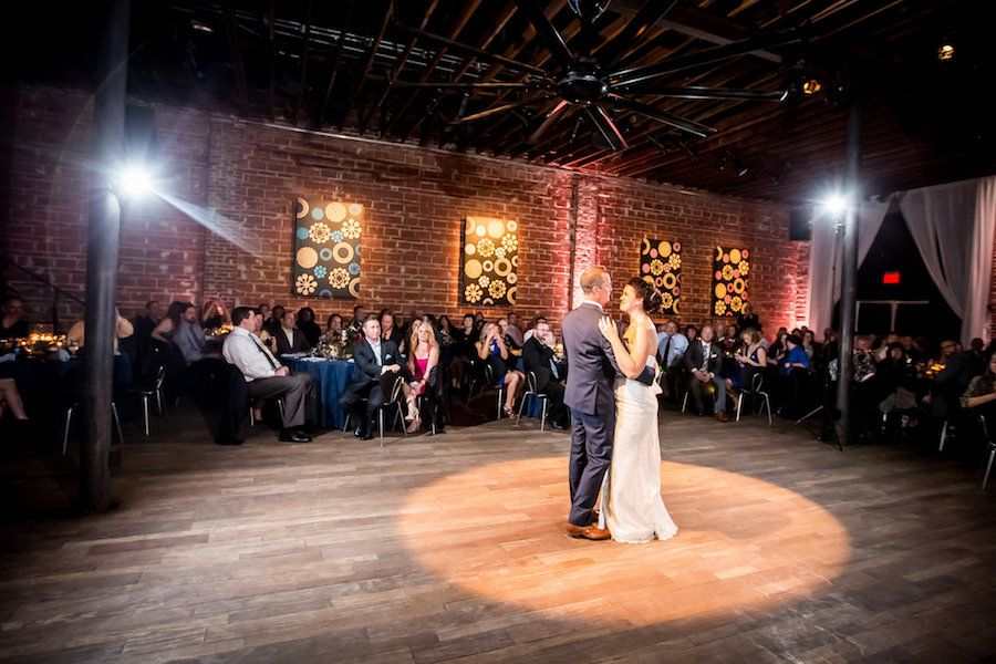 Bride and Groom First Dance Wedding Portrait with Exposed Brick Wall Backdrop at Modern, Downtown St. Pete Wedding Venue NOVA 535