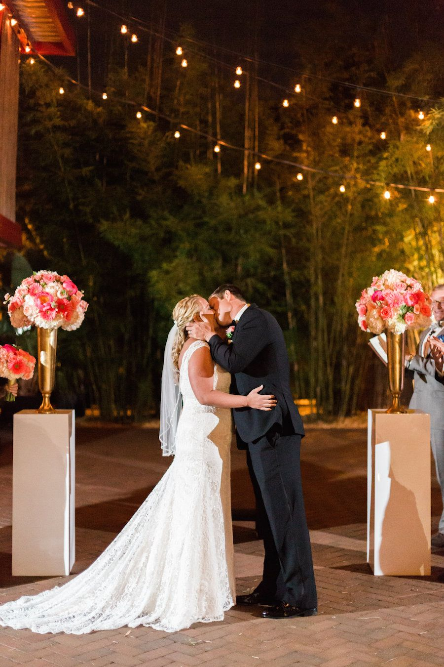 Outdoor, St Pete Wedding Ceremony, Bride and Groom First Kiss Portrait| St. Pete Wedding and Event Space NOVA 535 Black, Gold and Pink Downtown St. Petersburg Wedding