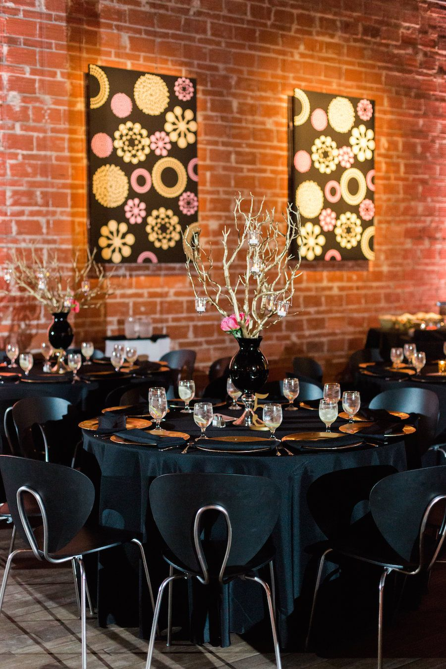 St. Pete Wedding Reception Table Decor with Wooden Twigs in Black Vase Centerpieces with Candles |Black and Chrome Wedding Reception Chairs| St. Pete Wedding and Event Space NOVA 535