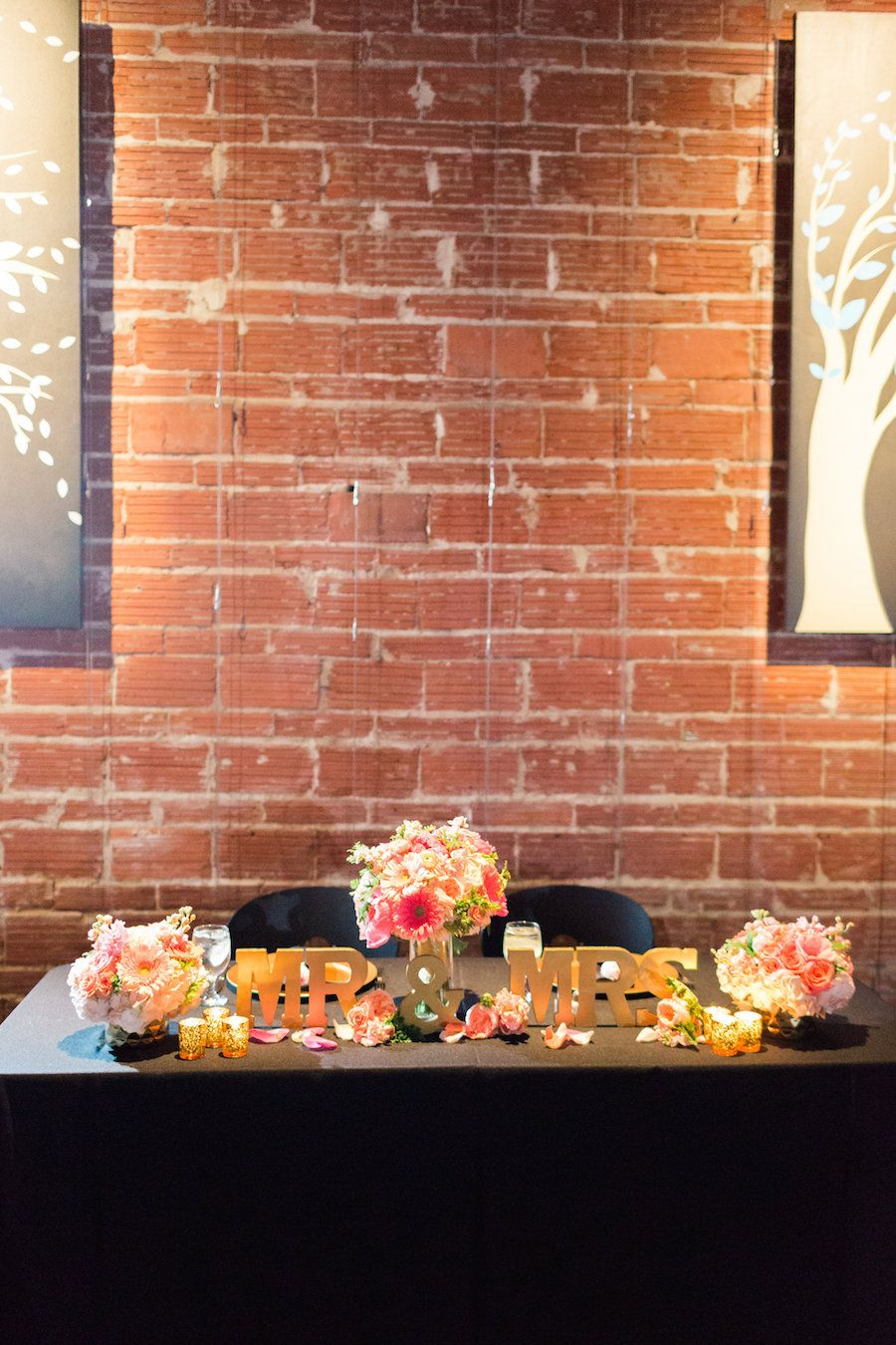 St. Pete Wedding Reception Sweetheart Table Decor with Gold Mr & Mrs Blocks and Coral and Ivory Flowers | Wedding Venues with Brick Walls in St. Pete Wedding and Event Venue NOVA 535