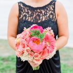 St. Pete Bridesmaid in Navy Blue Bridesmaids Dress and Bright Coral and Pink Wedding Bouquet of Flowers