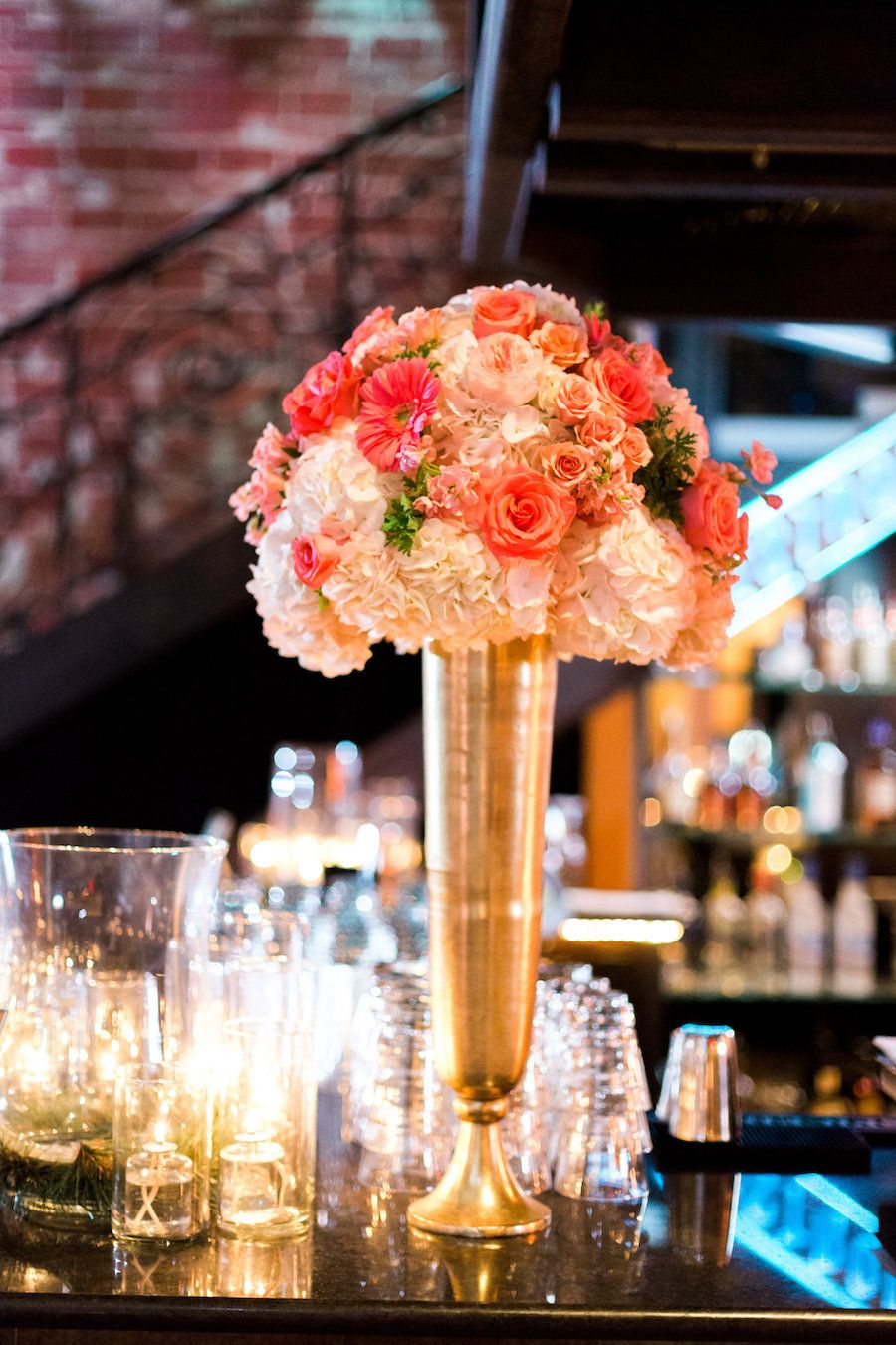 St Pete Wedding Reception Table Decor With Candlelight And Ivory Coral Bouquet Of Flowers In Tall Gold Centerpieces