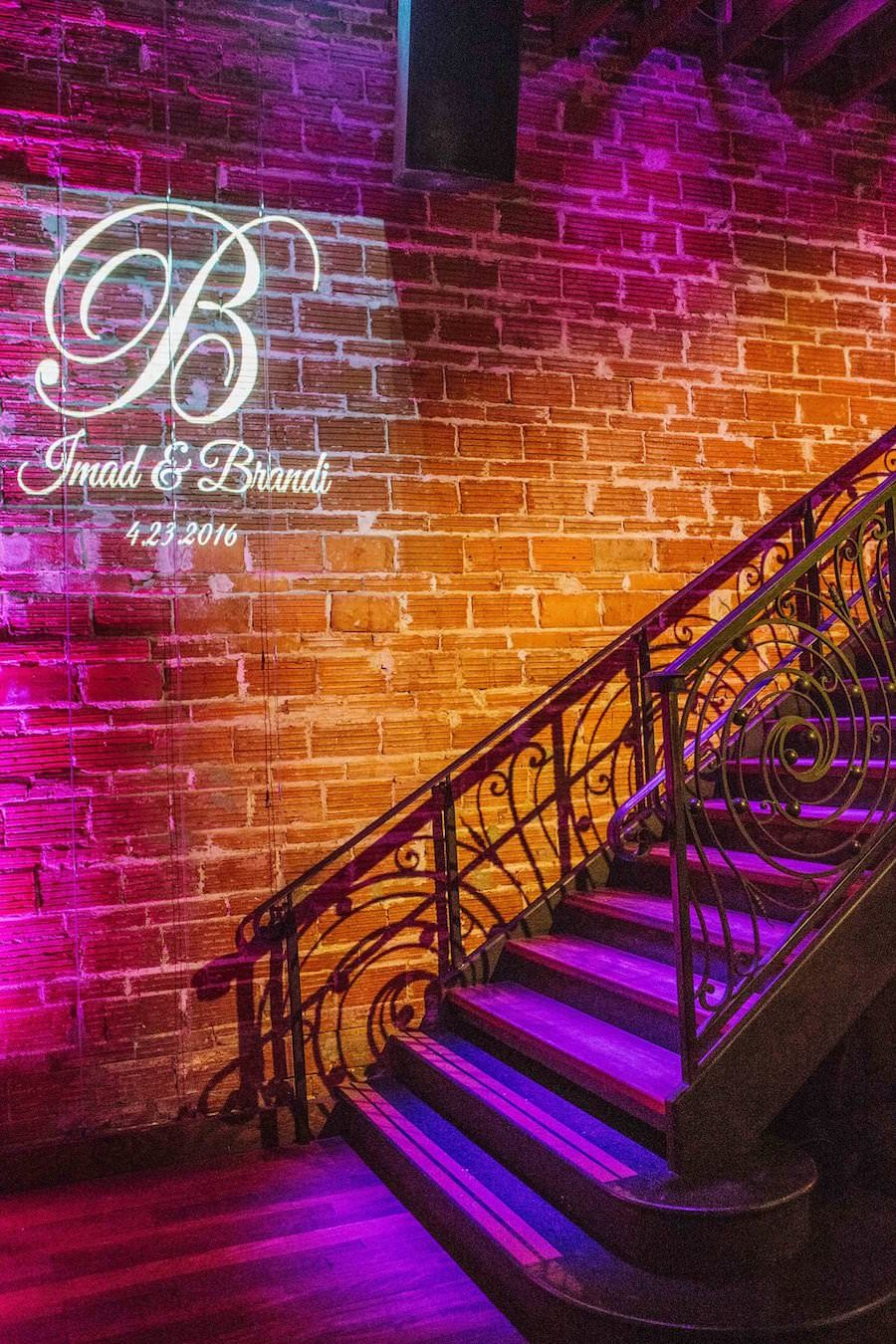 Wedding Reception with Purple and Gold Uplighting and Custom GOBO Monogram Initials | Downtown St Pete Wedding Venue NOVA 535 | Purple Orange and Turquoise Moroccan Inspired St. Pete Wedding
