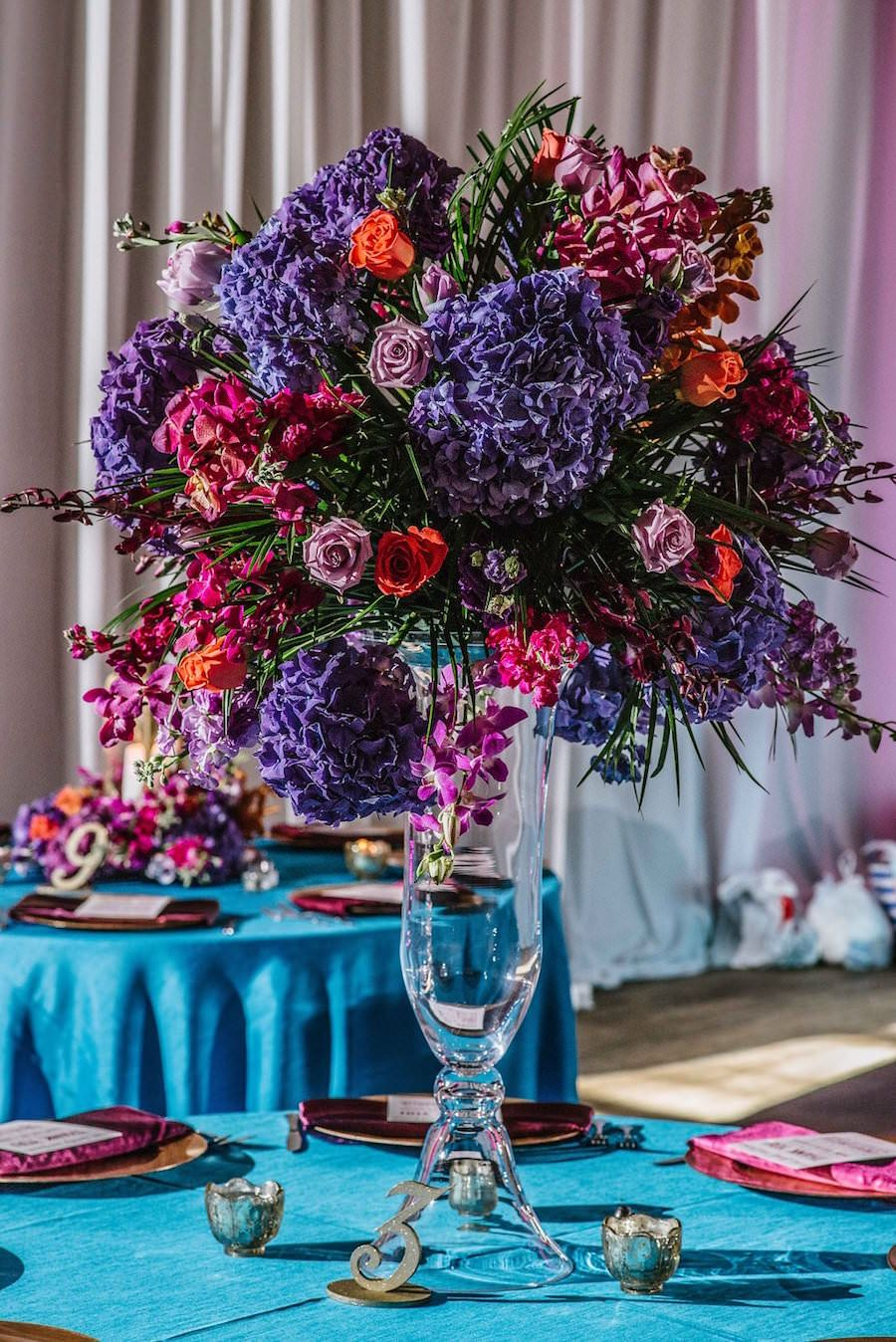 Tall Purple, Orange and Magenta Wedding Centerpiece Flowers in Glass Vase on Teal Linens | St. Petersburg Wedding Venue NOVA 535 | Purple Orange and Turquoise Moroccan Inspired St. Pete Wedding