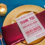 Gold and Purple Wedding Table Setting with Gold Charger and Magenta Red Napkin and Thank You Stationery Menu Card on Teal Linens at St. Petersburg Wedding Venue NOVA 535