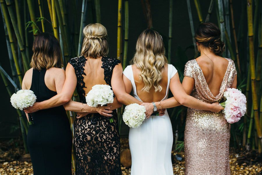 Bridal Party Wedding Portrait with Mismatched Black and Gold Bridesmaid Dresses and Ivory, Sheath Backless Mikaella Wedding Dress | Outdoor Bamboo Courtyard Downtown St. Pete Wedding Venue NOVA 535