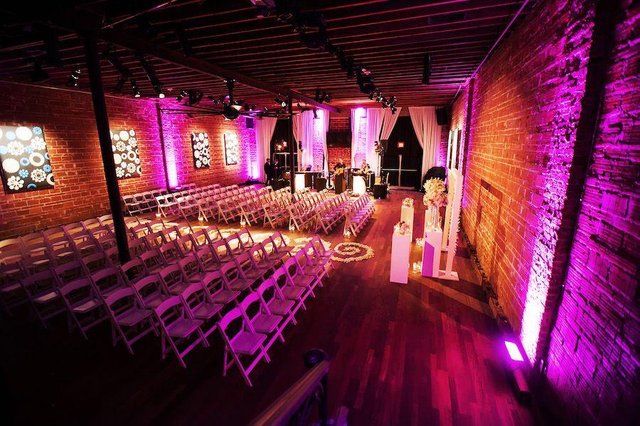 Indoor, St Petersburg Wedding Ceremony with Exposed Brick Walls and Purple Uplighting | St. Petersburg Wedding Venue NOVA 535