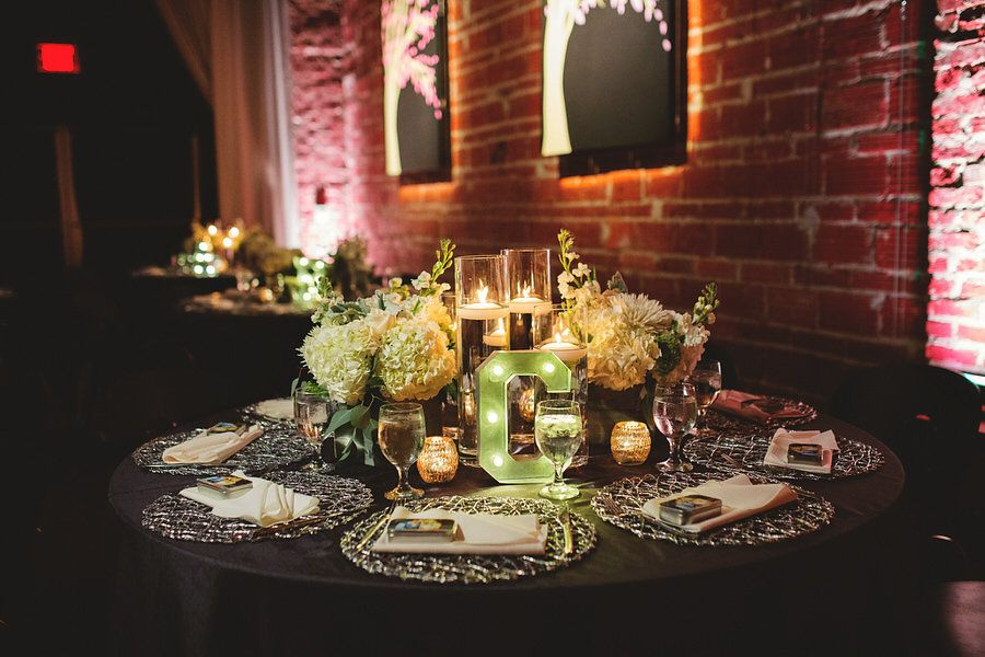 Modern Industrial Chic Wedding Reception Decor with Gunmetal and Ivory Centerpieces with Floating Candles, Silver Chargers and Lighted Marquee Letters | St. Petersburg Wedding Venue NOVA 535