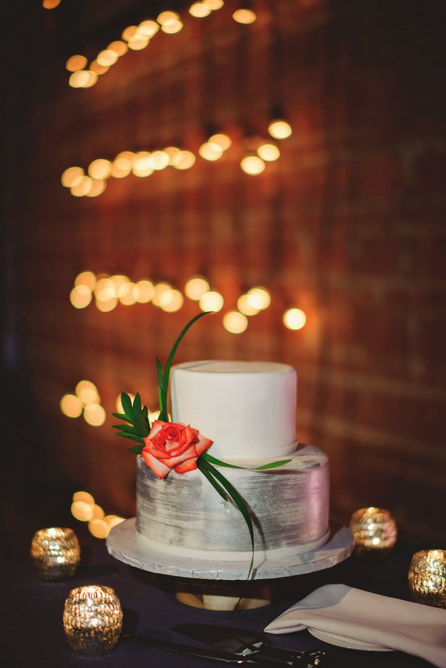 Modern Chic-Inspired Two Tier Round White and Silver Wedding Cake with Rose Accent