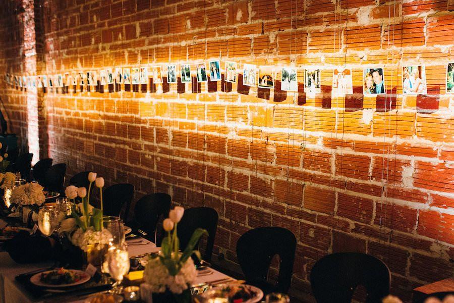Wedding Photo Reception Display Idea Hanging On Brick Wall | Modern St. Petersburg Wedding Venue NOVA 535