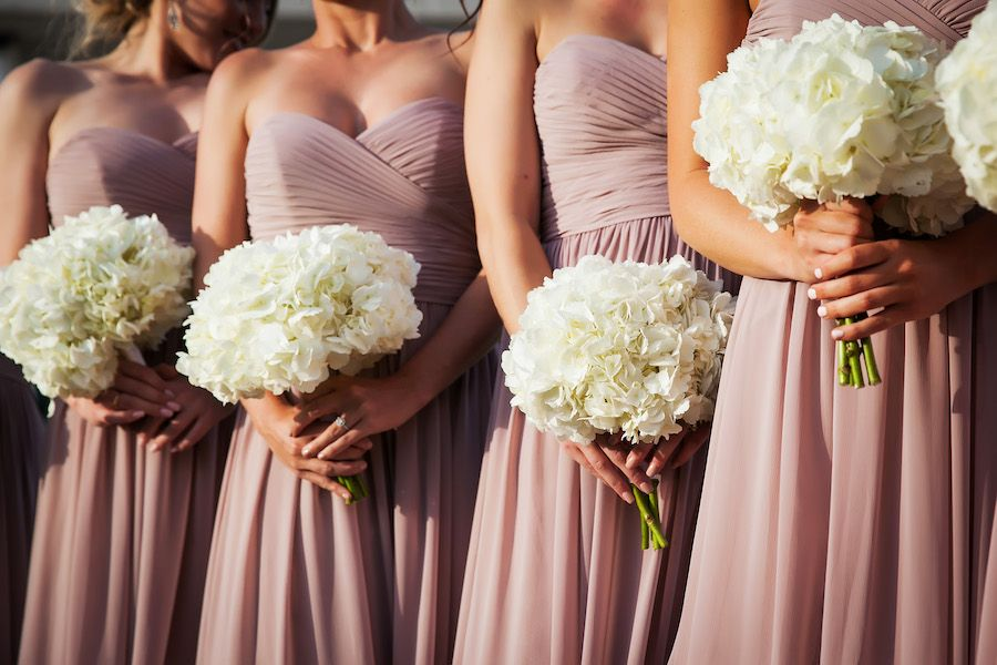 Bridesmaids with Dusty Rose Watters Chiffon Bridesmaids Dresses and Ivory Floral Bouquets