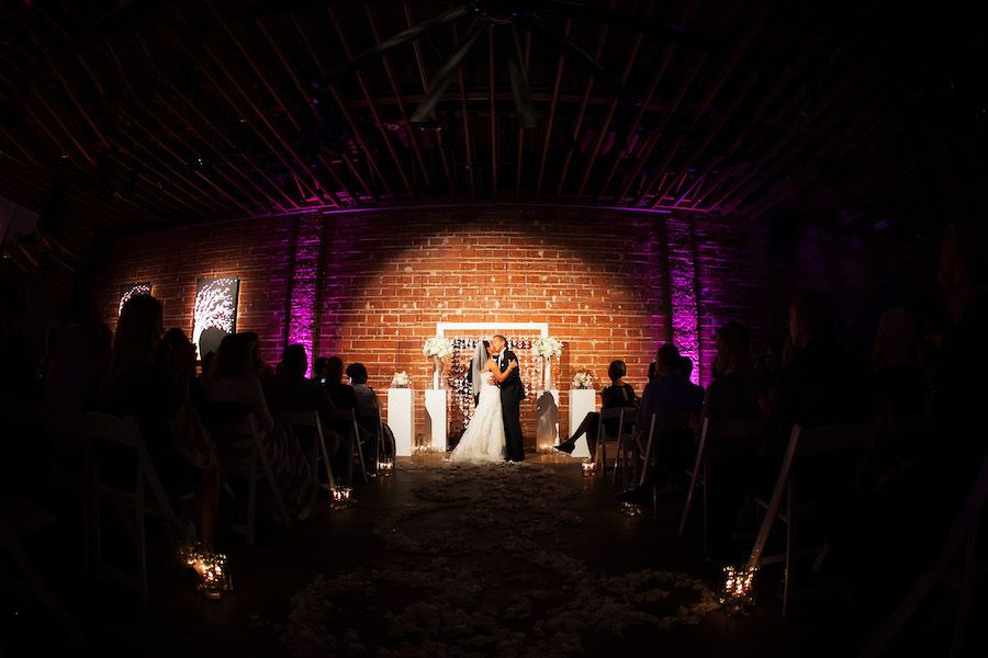 Modern Indoor Wedding Ceremony with White Altar and Brick Wall Backdrop | Downtown St. Pete Wedding Venue NOVA 535