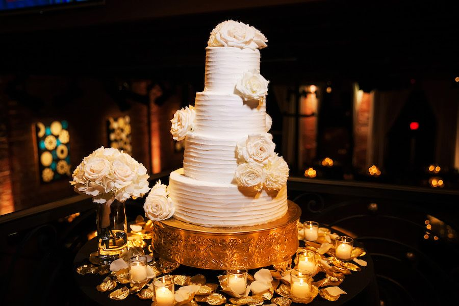 Four Tier Round White Wedding Cake with Roses on Gold Cake Stand