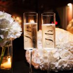 Mr and Mrs Champagne Flutes with White Rose Centerpieces Wedding Portrait