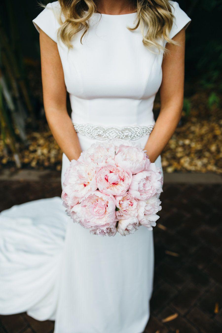 Bridal Wedding Portrait in Ivory, Cap Sleeve Sheath Mikaella Wedding Dress with Rhinestone Belt and Blush Pink Peony Wedding Bouquet