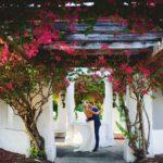 Bride Open Back Wedding Dress and Groom in Blue Suit Wedding Portrait in Downtown St. Pete