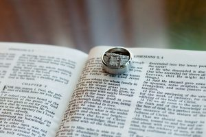 Bride and Groom Wedding Engagement Rings with Bible