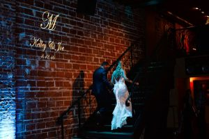 Unique Modern Downtown St. Pete Wedding Venue NOVA 535 with Brick Walls and Wrought Iron Staircase and Custom GOBO Lighting