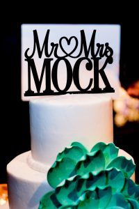 Simple White Three Tiered Round Wedding Cake with Teal Sugar Flower and Mr. Mrs Last Name Custom Cake Topper