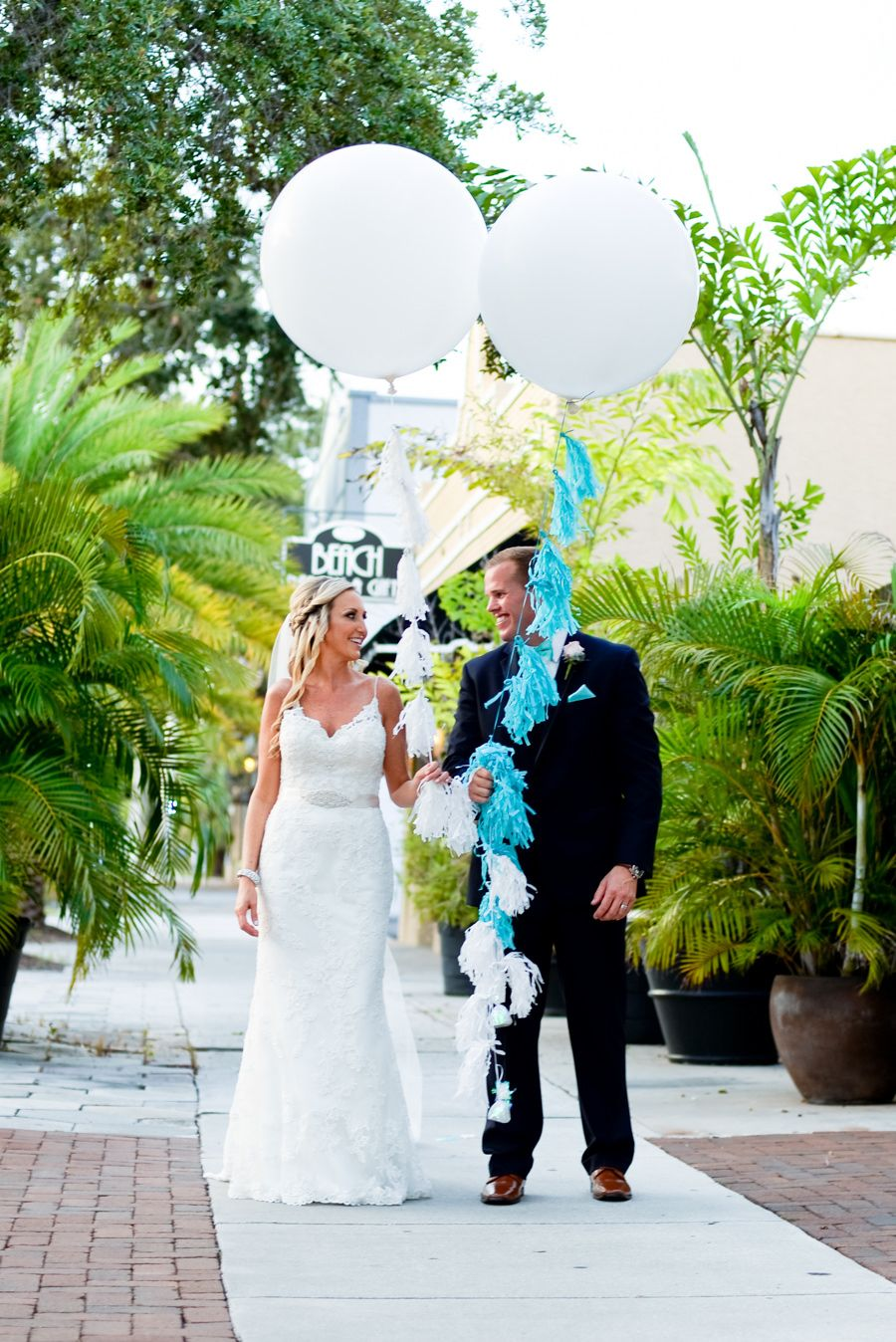 Downtown St. Pete Bride and Groom Wedding Portrait with Large, Oversized Balloons