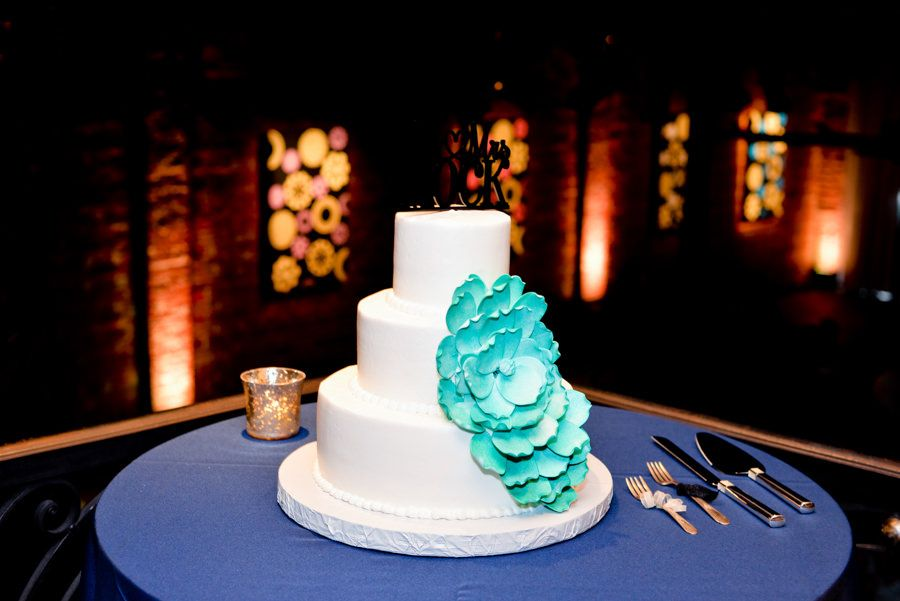 Simple White Three Tiered Round Wedding Cake with Teal Sugar Flower