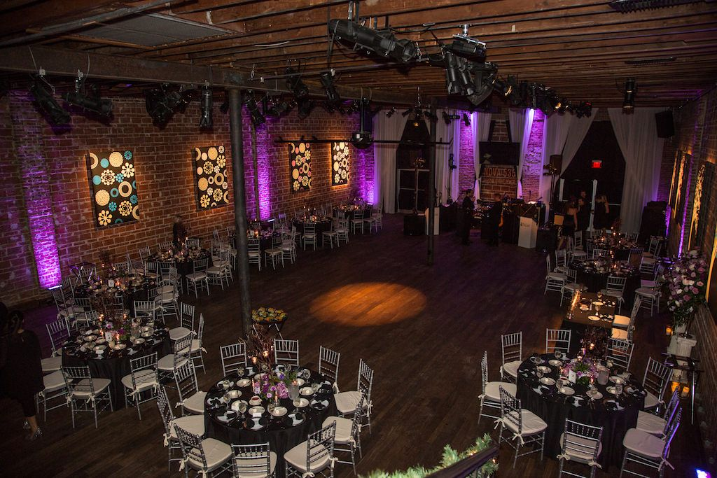 Modern Plum and Silver Indoor Wedding Reception with Purple Uplighting, Flowers, Black Linens, and Silver Chiavari Chairs | Downtown St Pete Modern Wedding Venue NOVA 535