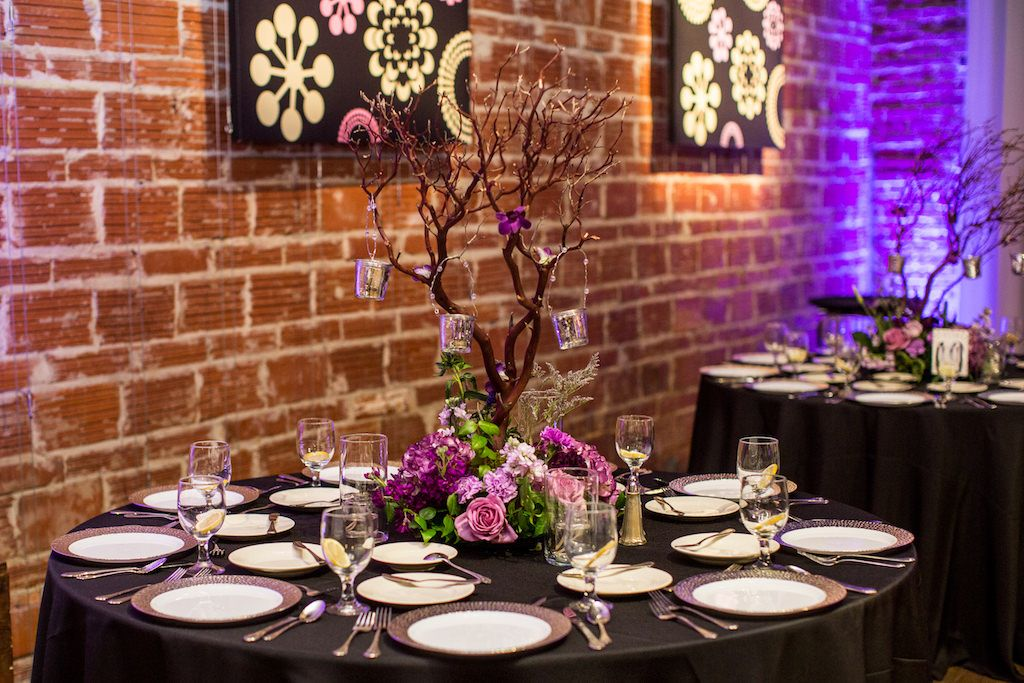 Modern Plum and Silver Wedding Reception Table with Organic Branch Centerpiece with Purple and White Flowers and Greenery and Miniature Hanging Silver Bucket Wedding Favors | Modern St Pete Wedding Venue NOVA 535