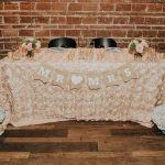 Rustic Bohemian Wedding Reception Bride and Groom Sweetheart Table with Blush Floral Linen, White Lily and Pink Rose Bouquets, and Brown Paper Mr and Mrs Banner | Downtown St Pete Wedding Venue NOVA 535