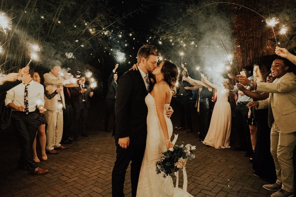 Outdoor Wedding Exit Portrait at St. Pete, FL historic DTSP venue NOVA 535 with Sparklers and pink boho Blush Floral with Greenery and White Ribbon Bouquet.