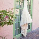 Allure Wedding Dress on Hanger on Green Door | Plum and Silver Traditional Meets Modern Downtown St Pete Wedding at Historic Venue NOVA 535