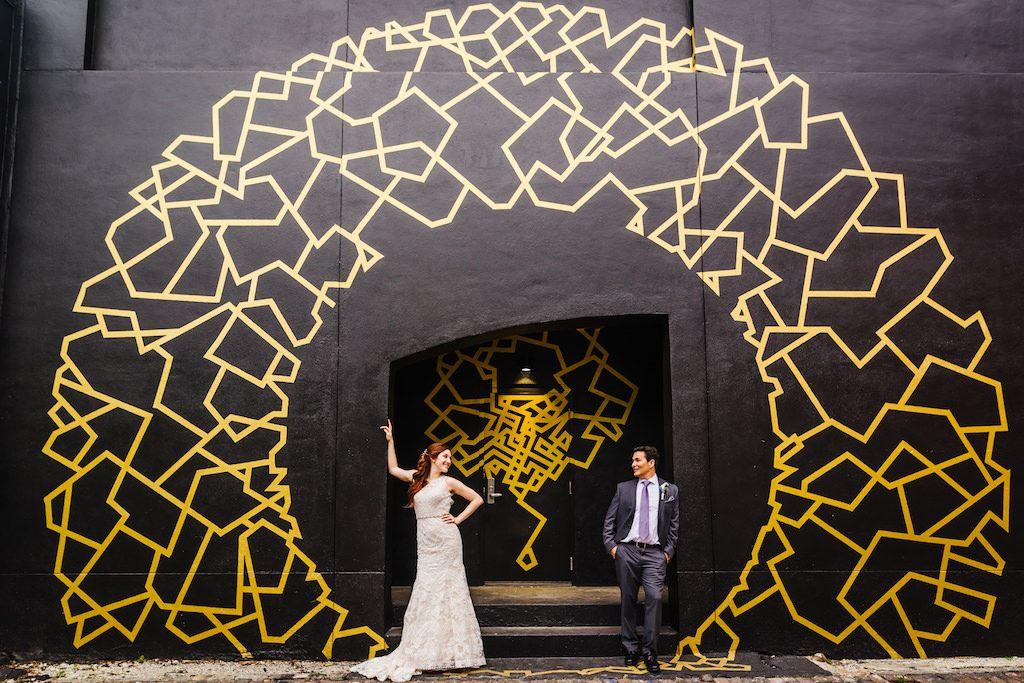 Downtown St Pete Street Art Industrial Wedding Portrait, Bride with Blue, Dusty Purple, and White Bouquet